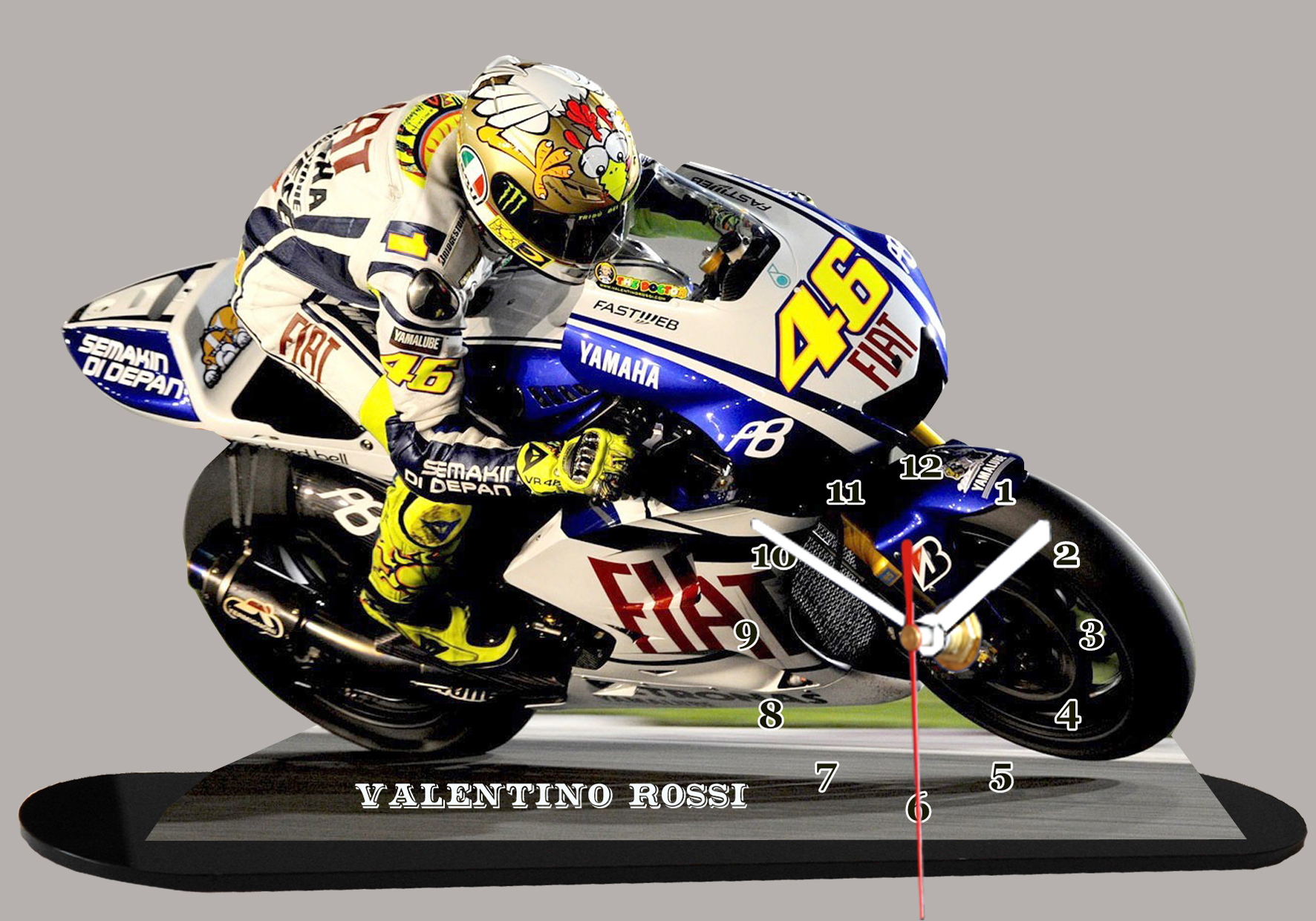 valentino rossi pilote moto gp sur yamaha en moto horloge. Black Bedroom Furniture Sets. Home Design Ideas